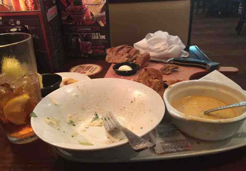 Longhorn Steakhouse Empy Plates Remain on Table
